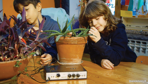 kids listening music of the plants device